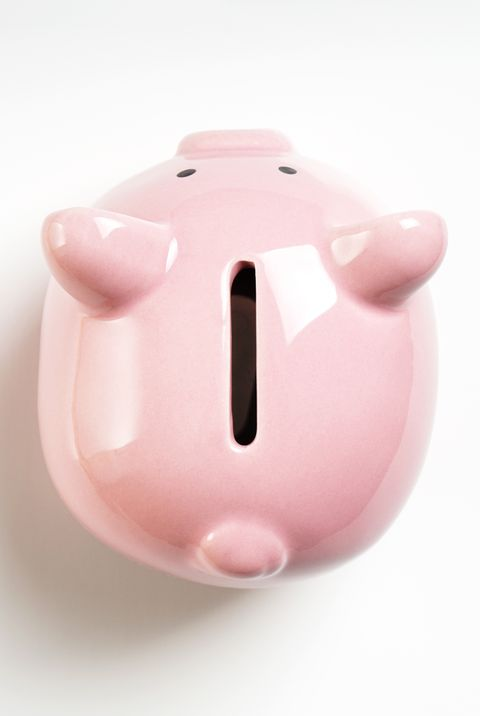 new years resolutions - Close-Up Of Piggy Bank On White Background