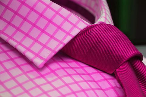 Close-Up Of Pink Shirt With Necktie