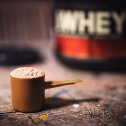 close up of protein powder in scoop on table