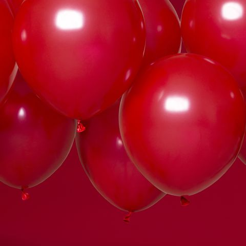 close up of red balloons