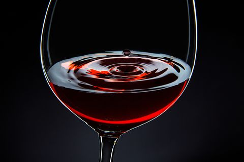 Close-Up Of Red Wine Against Black Background