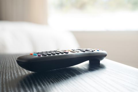 Close-Up Of Remote Control On Table At Home