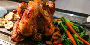 Close-Up Of Roasted Chicken On Slate