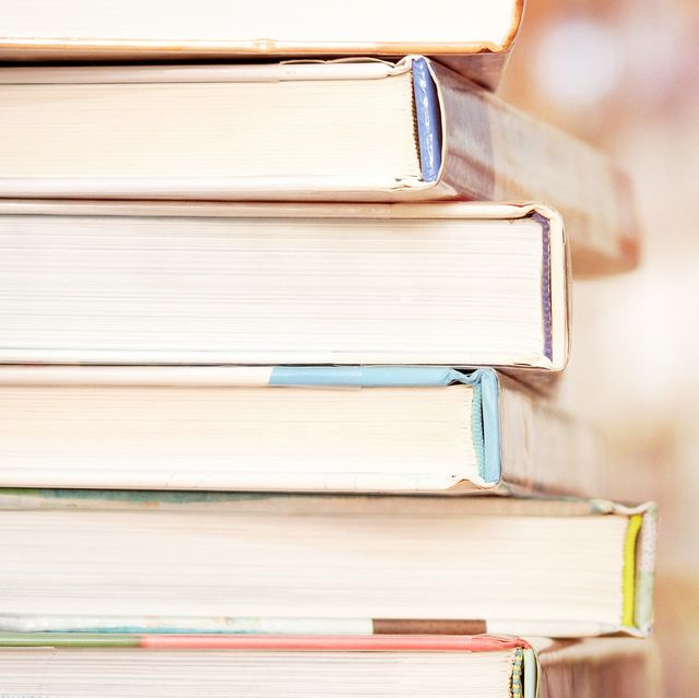 Close-Up Of Stacked Books In Library