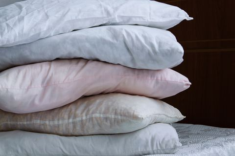 Close-Up Of Stacked Pillows On Bed At Home
