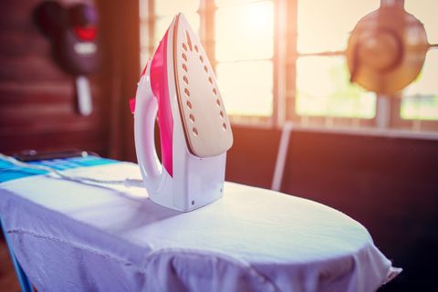 Close-Up Of Steam Iron On Table At Home