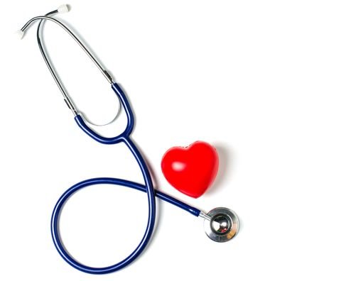 Close-Up Of Stethoscope And Heart Shape On White Background