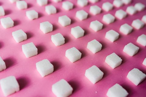 Close-Up Of Sugar Cubes Arranged On Pink Table