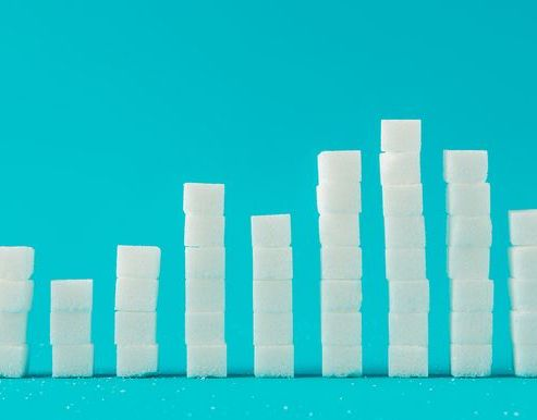 Close-Up Of Sugar Cubes Graph Against Blue Background