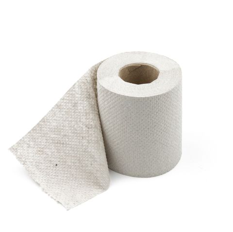 Close-Up Of Toilet Paper Against White Background