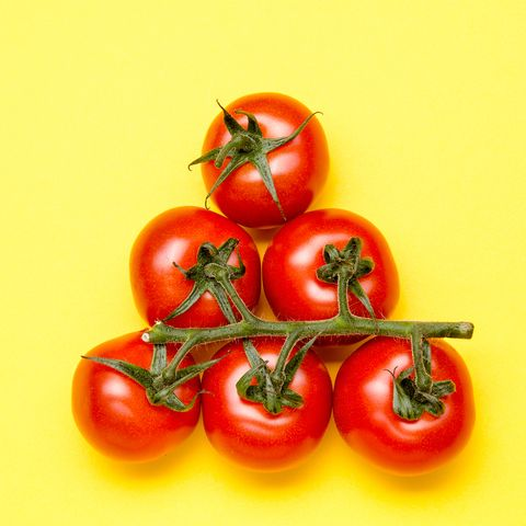 Close-Up Of Tomatoes Against Yellow Background