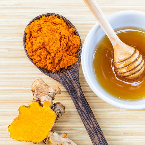 Close-Up Of Turmeric And Honey On Table