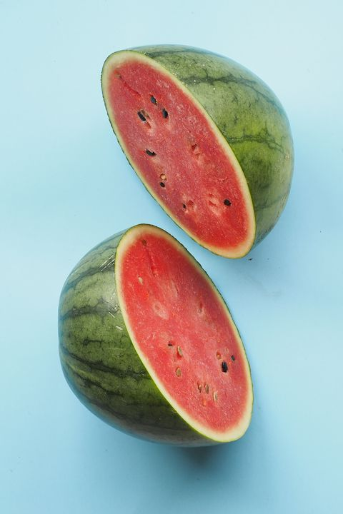 Close-Up Of Watermelon Slices On Blue Background