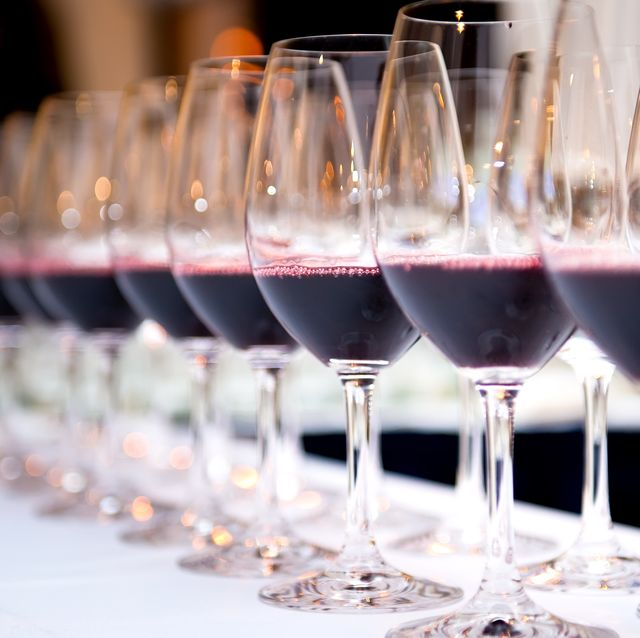 Close-Up Of Wineglass In Row On Table