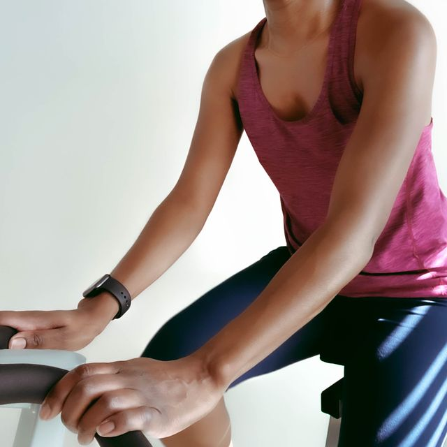 close up of woman on exercise bike