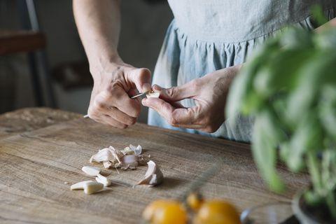 Close-up of woman peeling garlic