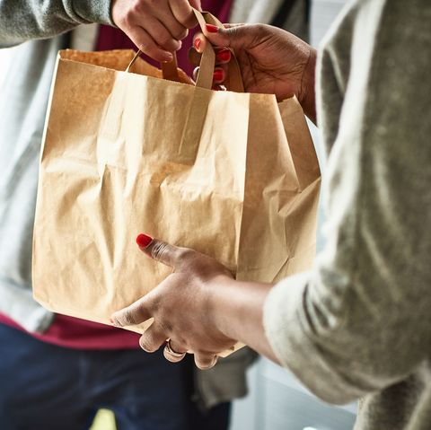 close up of woman receiving take away food delivery