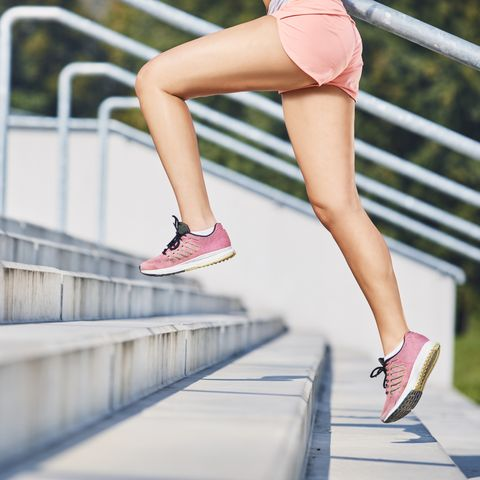 close up of woman running on stairs