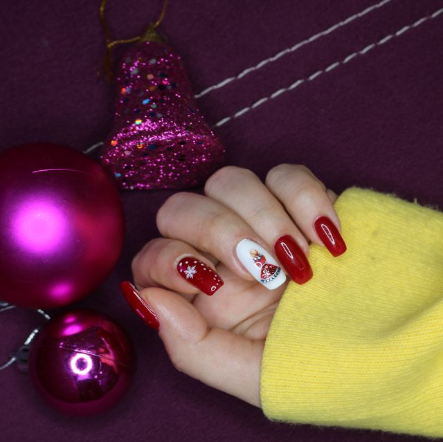 woman showing christmas nails
