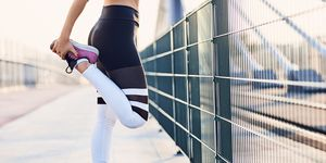 Close-up of woman stretching legs after running