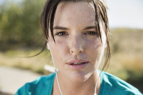 Close-up of woman sweating during outdoor workout.