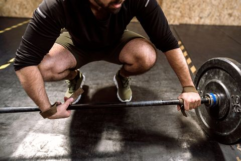 Close up of young weightlifter Preparing for dead-lifting