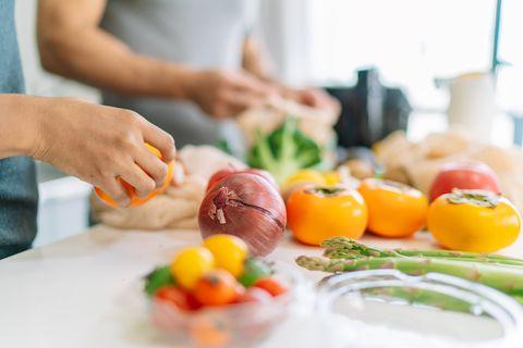 close up photo of woman's hand while preparing vegan food at home