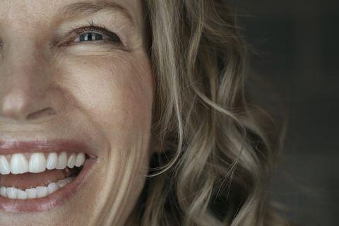 Close up portrait confident, enthusiastic, laughing senior woman