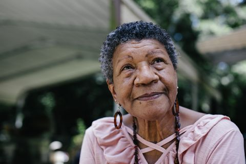 close up portrait of senior black woman looking thoughtful