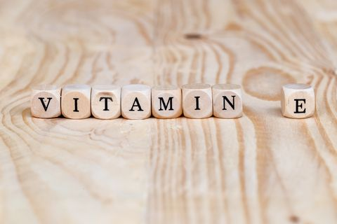 close up vitamin e word made from wooden letters on the table