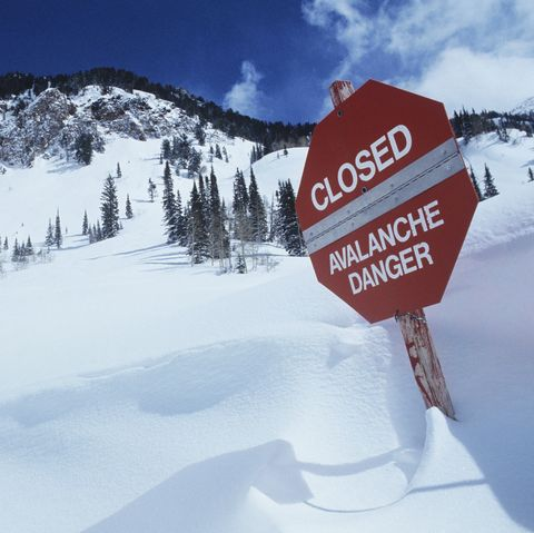 closed avalanche danger sign on slope
