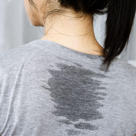 closeup asian woman back sweating because of hot weather