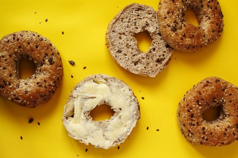 Closeup of a 12 grain bagel with butter