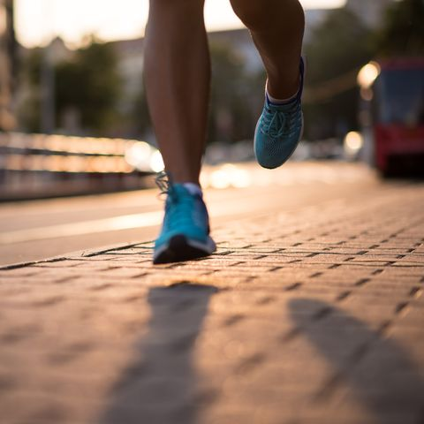 closeup of athlete feet in running shoes