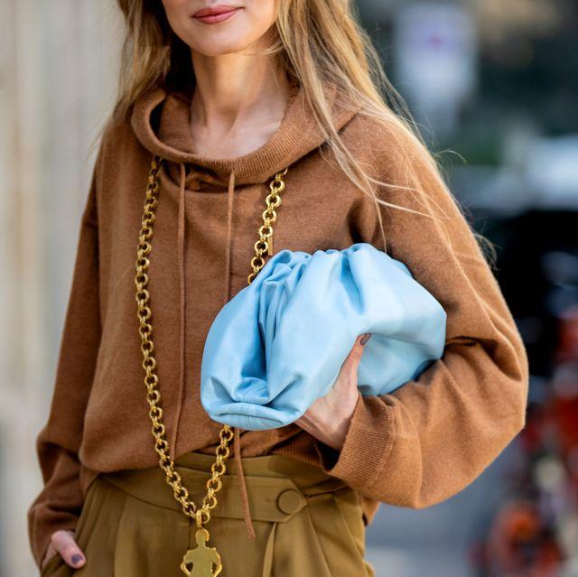 Clothing, Street fashion, Outerwear, Coat, Fashion, Trench coat, Fashion model, Overcoat, Shoulder, Jacket,