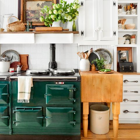 Furniture, Shelf, Room, Green, Interior design, Table, Turquoise, Home, Living room, Wall,