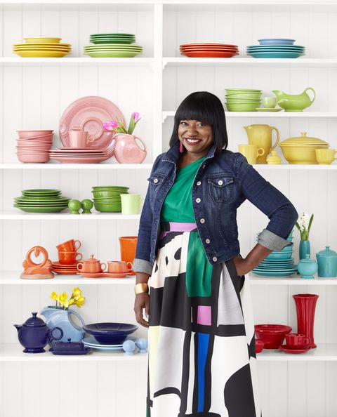 cheryl luckett with her collection of fiestaware