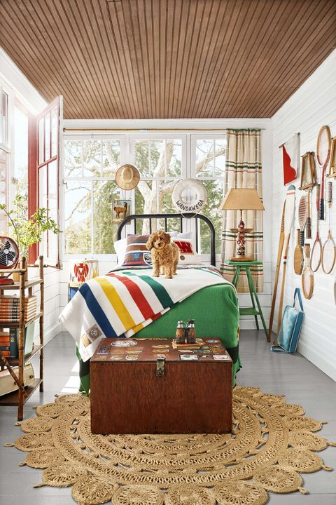 bedroom with vintage footlocker  camp theme, dog on bed