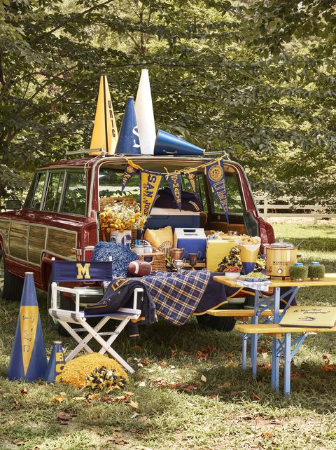 1984 grand wagoneer tailgating party with food and football memorabilia