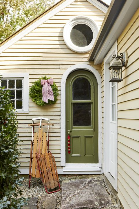 an entryway decorated with antique sleds