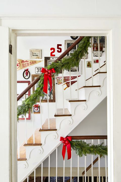 christmas garland with red bows on a staircase