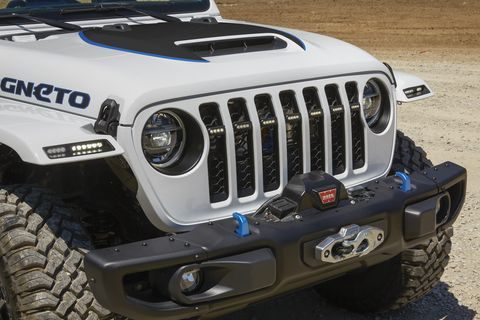 the jeep® magneto bev concept comes equipped with a jpp 2 inch lift kit, 17 inch lights out black metallic wheels with 35 inch mud terrain tires, custom roll cage, mopar rock rails, steel bumpers with a warn winch and a steel belly pan for added off road capability
