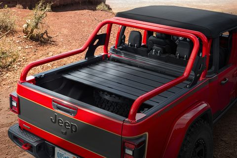 gladiator red bare boasts a fire cracker red exterior with custom matte black graphics and gold accents, a black factory soft top and half doors for open air freedom, plus a cargo bed mounted sport bar and bed cover and rack system to store tons of off roading gear