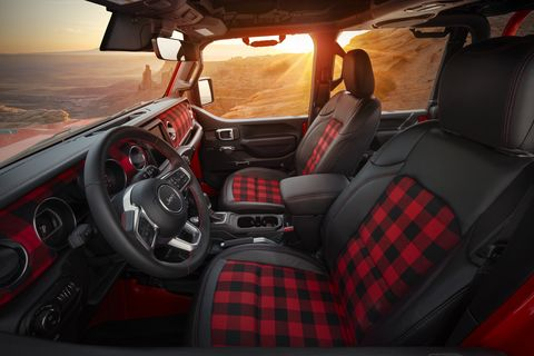 the gladiator red bare's interior incorporates custom katzkin black leather seats with red stitching and custom red flannel inserts the instrument panel has been wrapped in the same red flannel material, giving the interior a bold, rustic finish
