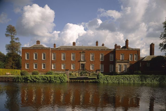 north front of dunham massey with moat in foreground this elizabethan house was extensively remodelled in 1732 40 for the 2nd earl of warrington the architect was john norris