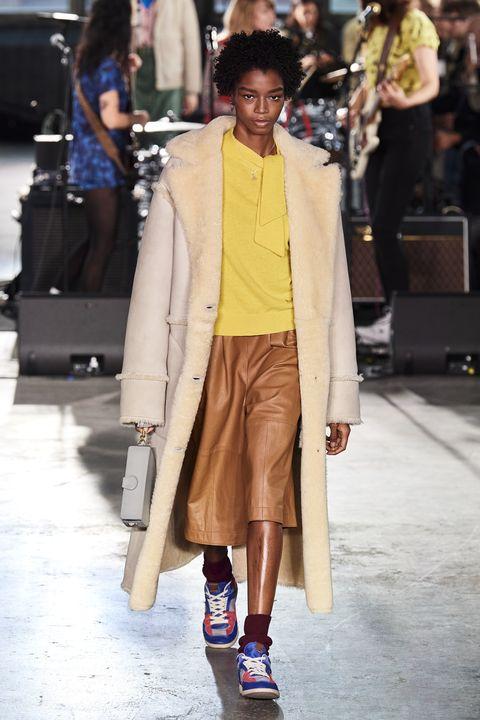 Fashion, Fashion model, Clothing, Street fashion, Fashion show, Coat, Footwear, Snapshot, Outerwear, Yellow,