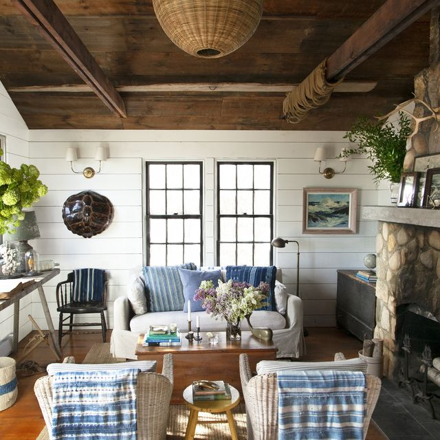 cozy, coastal living room with blue and white textiles