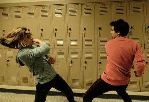 xolo maridueña tanner buchanan fight scene as miguel and robby in season 2 of netflix's cobra kai