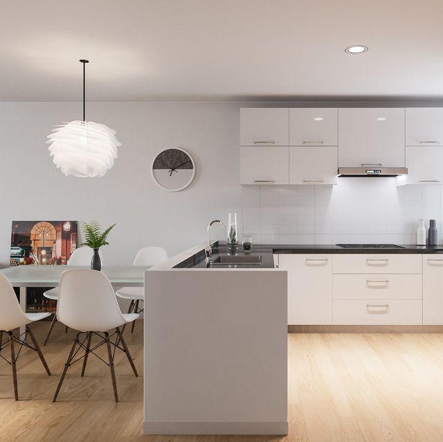 cocina blanca moderna abierta al salón comedor
