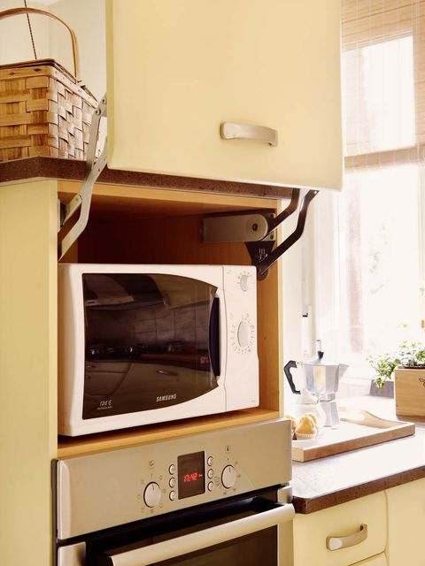 Room, Property, Furniture, Kitchen appliance, Kitchen stove, Kitchen, Cabinetry, Microwave oven, Oven, Interior design,